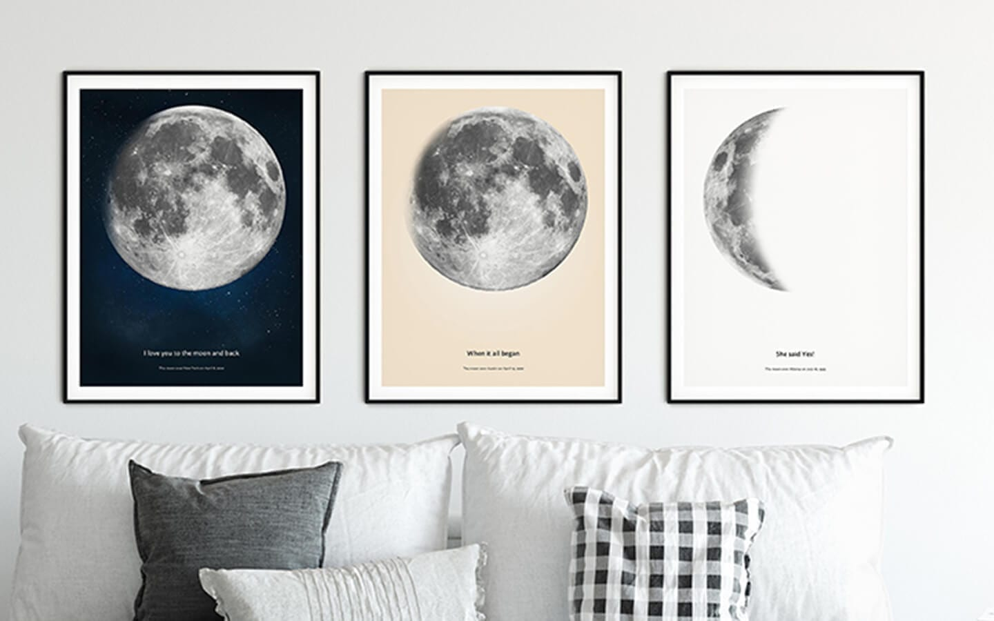 Three moon phase posters hanging as a wall decor above the sofa in living room