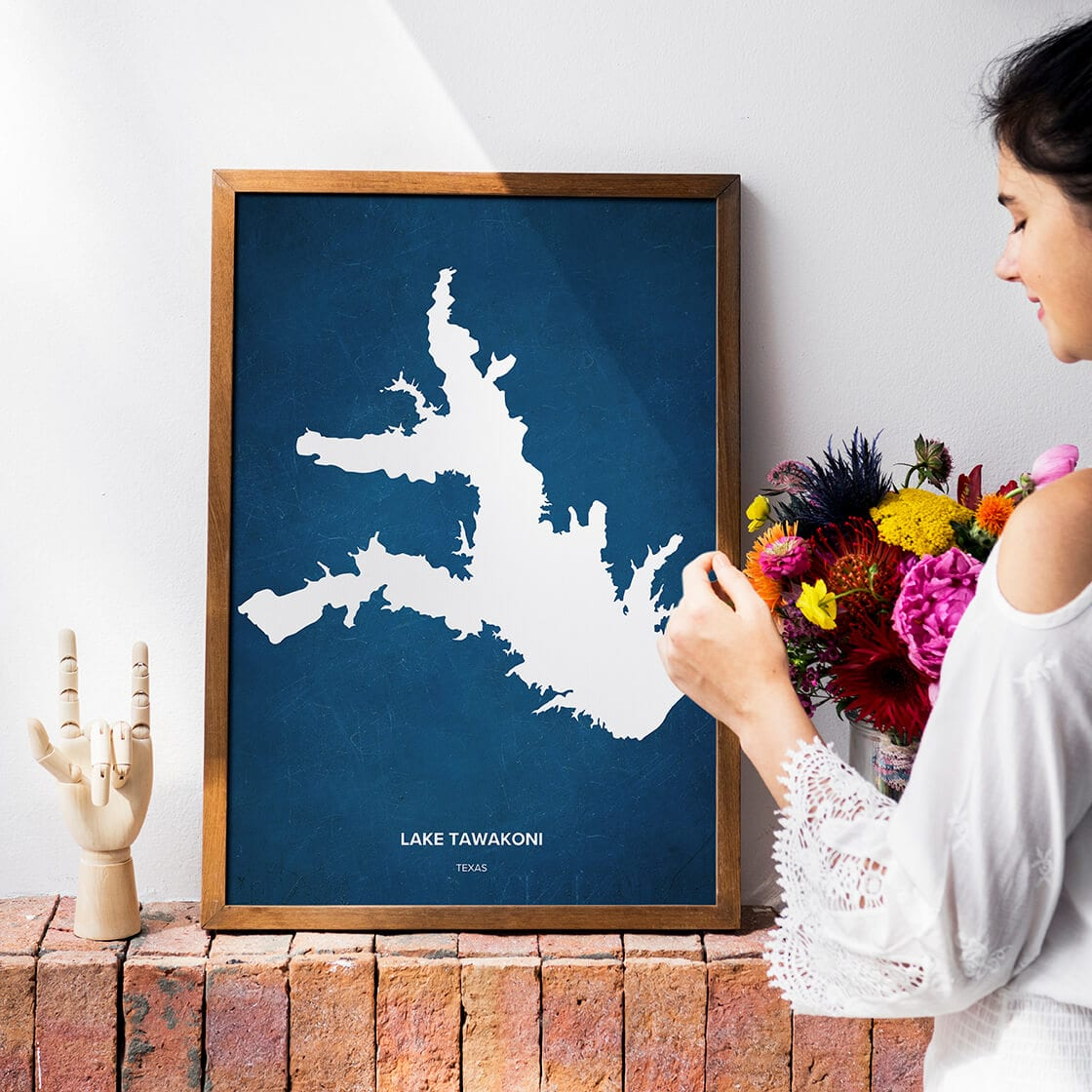 an apartment decorated with flowers and a Lake Tawakoni map poster.